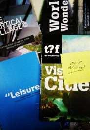 OUT NOW_visionary Cities_pile of books